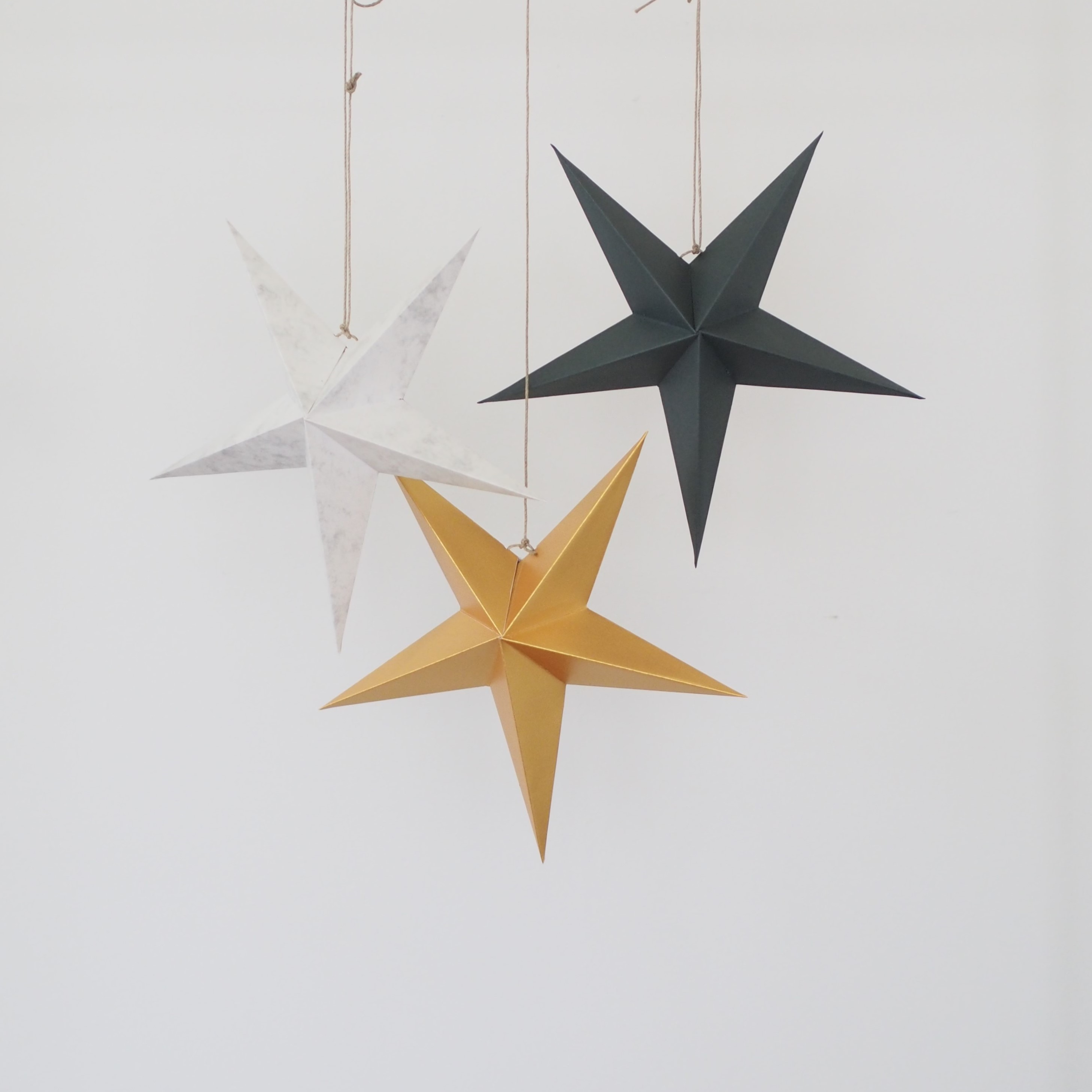 Tähdet 30 cm 10,50/kpl Marmori/kulta/havunvihreä